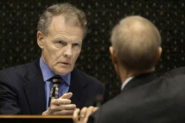 In this Feb. 17, 2016 photo, Illinois Speaker of the House Michael Madigan reaches out to shake Illinois Gov. Bruce Rauner's hand after Rauner delivered the State of the Budget Address to a joint session of the General Assembly.