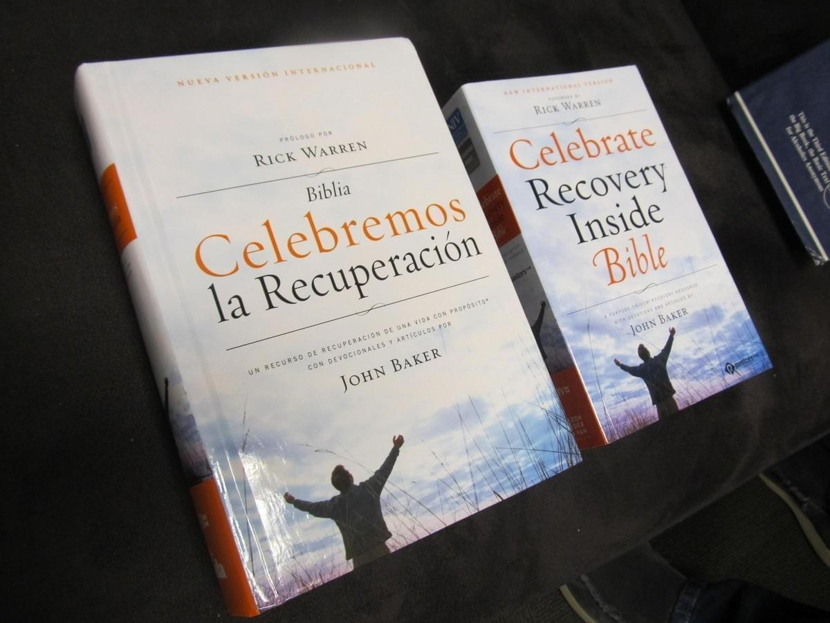"""Copies of the """"Celebrate Recovery Inside Bible"""" in english and spanish."""