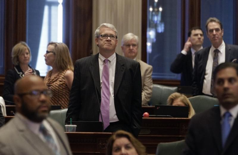 Illinois House Minority Leader Jim Durkin, R-Western Springs, center, listens to House Speaker Michael Madigan, D-Chicago, speaks to lawmakers at the state Capitol on Thursday, May 26, 2016, in Springfield.