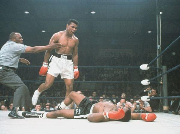 Muhammed Ali stands over Sonny Liston after knocking him out in 1965.