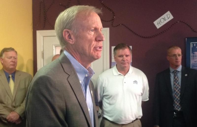 Illinois Governor Bruce Rauner speakin to school superintendents in Bloomington.