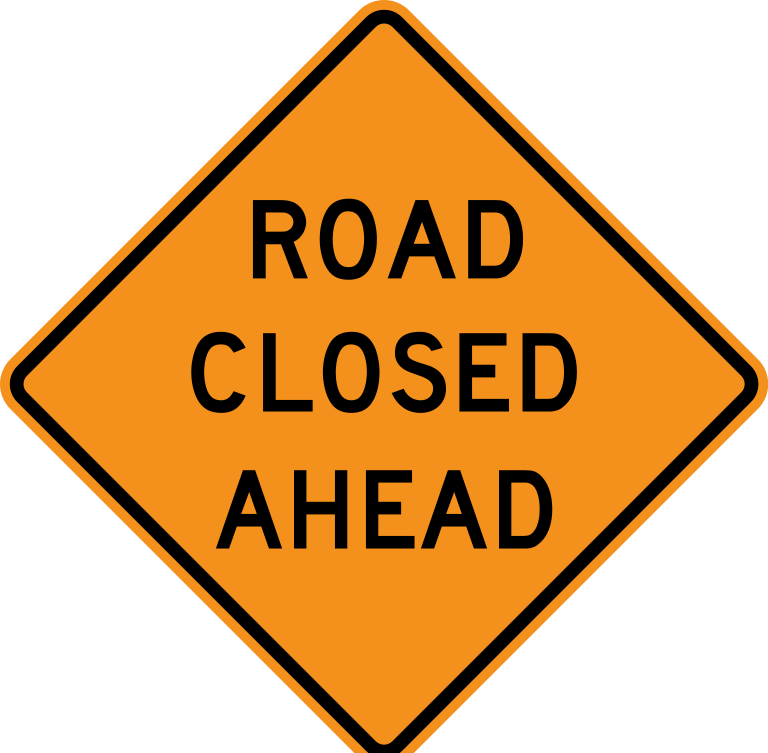"""""""Road Closed Ahead"""" highway sign."""