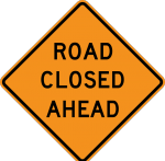 """Road Closed Ahead"" highway sign."