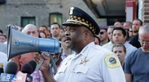 Chicago Police Superintendent Eddie Johnson speaks with members of LGBT groups and their supporters at a vigil in the city's Lakeview neighborhood on Sunday.