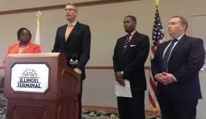 State Treasurer Mike Frerichs, joined by State Rep. Carol Ammons, AARP Associate Director Andre Jordan, and Senator Scott Bennett at the Illinois Terminal in Champaign.