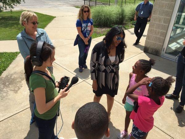 Niala talking to children
