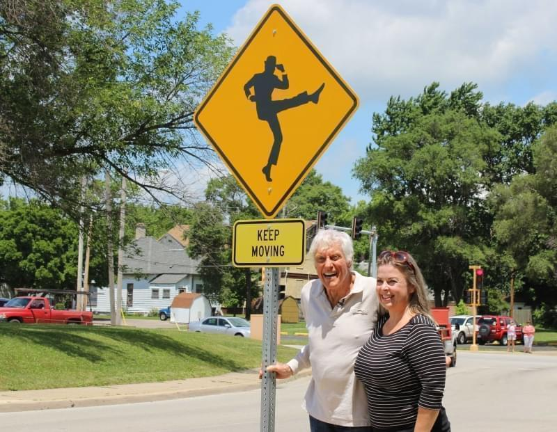 Dick Van Dyke is joined by his wife Arlene with the unveiling of the 'Keep Moving' street sign outside Danville High School.