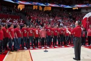 Mark Grizzard directing the ISU Mens Glee Club at Redbird Arena