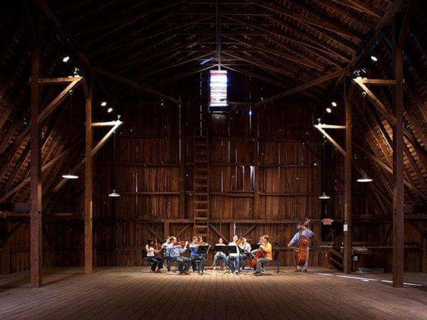 band performing in barn