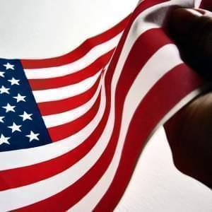 Hand clasping an American flag