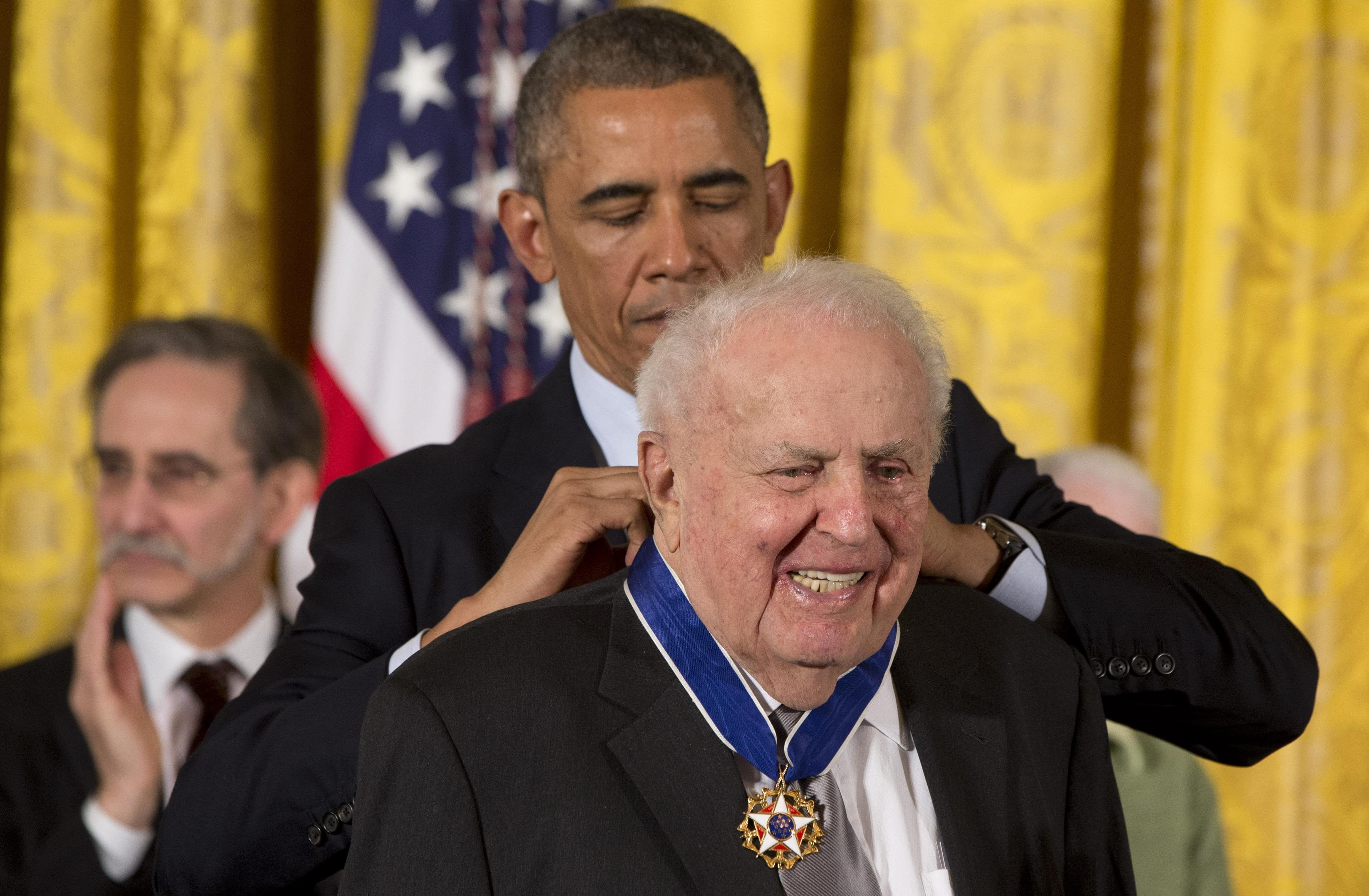 President Barack Obama awards former Illinois Rep. Abner Mikva the Presidential Medal of Freedom, Monday, Nov. 24, 2014, during a ceremony in the East Room of the White House in Washington.