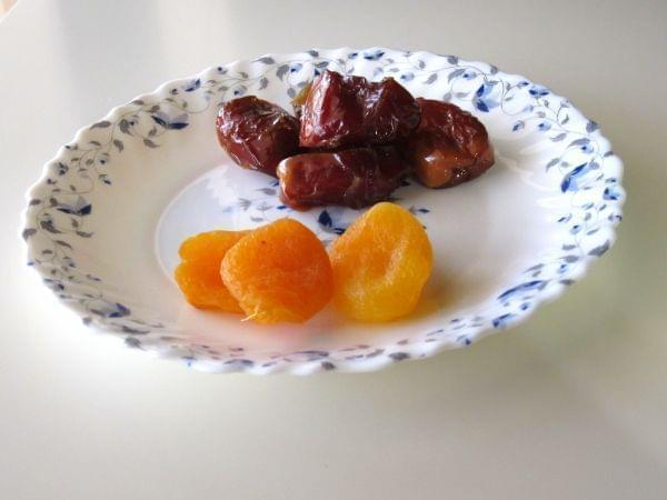 A plate of dates and dried apricots