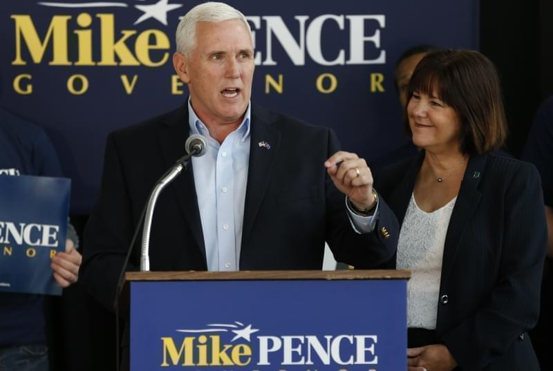 In this May 11, 2016 file photo, Indiana Gov. Mike Pence, alongs with his wife Karen, right, launches his campaign for re-election during an event in Indianapolis. Republican Donald Trump has narrowed down his vice presidential shortlist to a handfu