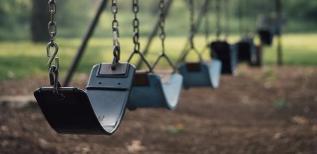 Child's swings iin playground.