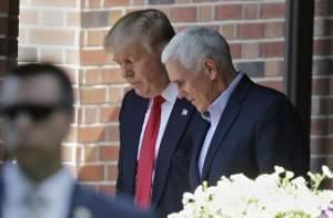 Republican presidential candidate Donald Trump leaves the Indiana Governor's residence with Gov. Mike Pence in Indianapolis on Wednesday.