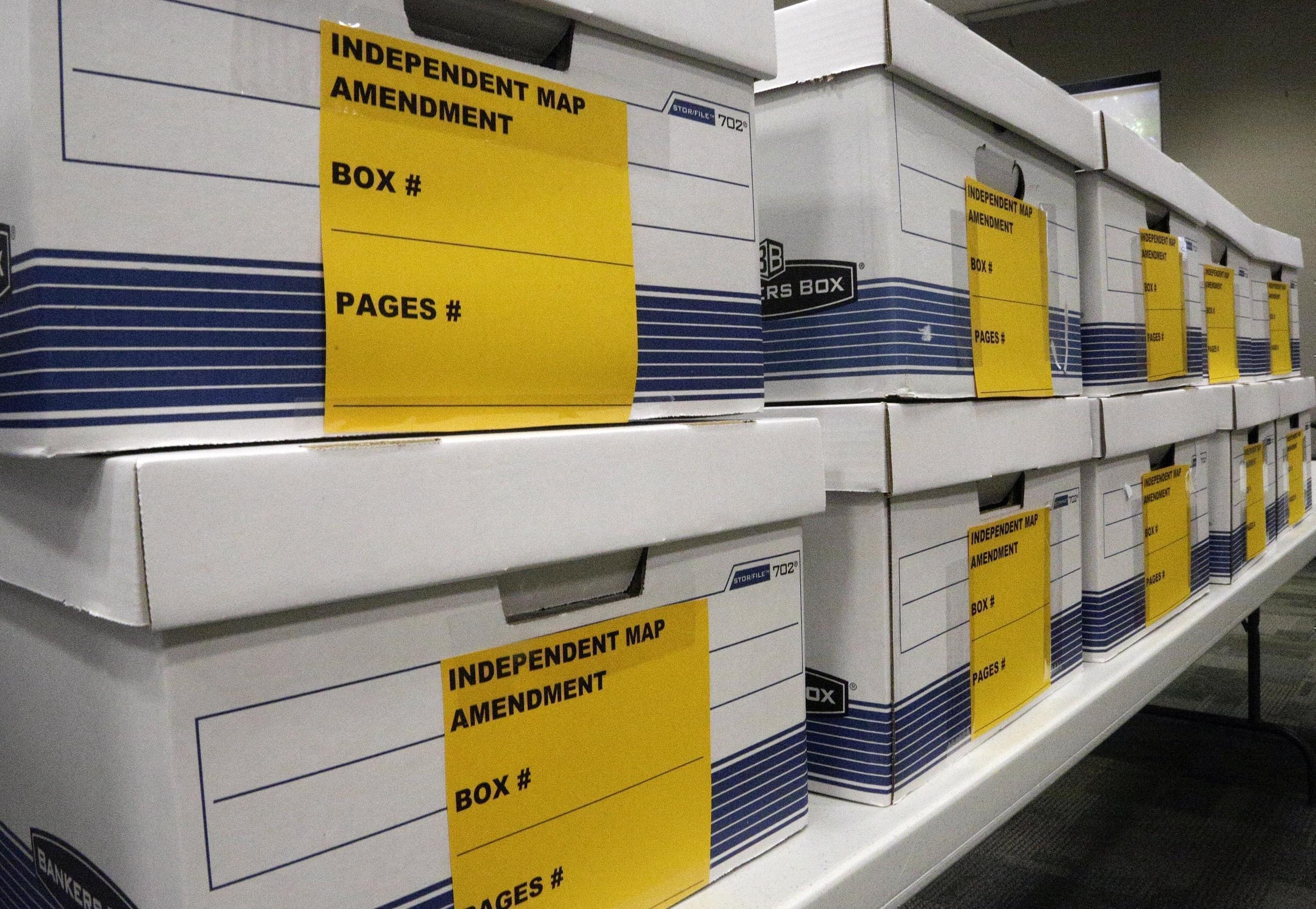 In this May 6, 2016, file photo, boxes are stacked that will hold signature petitions at the Illinois State Board of Election office in Springfield, Ill.