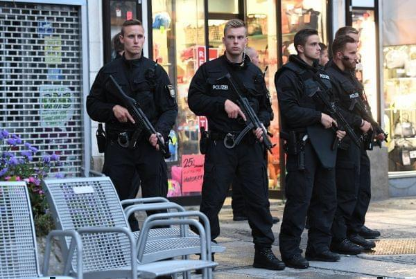 Police officer secure the Stachus hotel after a shooting was reported at a nearby shopping mall in Munich,