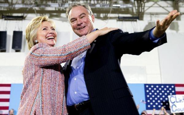 n this July 14, 2016, file photo, Democratic presidential candidate Hillary Clinton, accompanied by Sen. Tim Kaine, D-Va., speaks at a rally at Northern Virginia Community College in Annandale, Va. Clinton has chosen Kaine to be her running mate