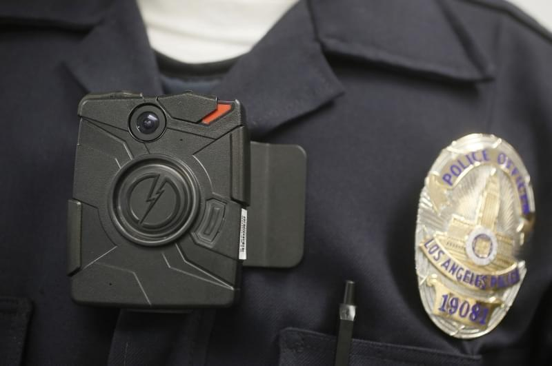 In this Jan. 15, 2014 file photo, a Los Angeles Police officer wears an on-body camera during a demonstration in Los Angeles.
