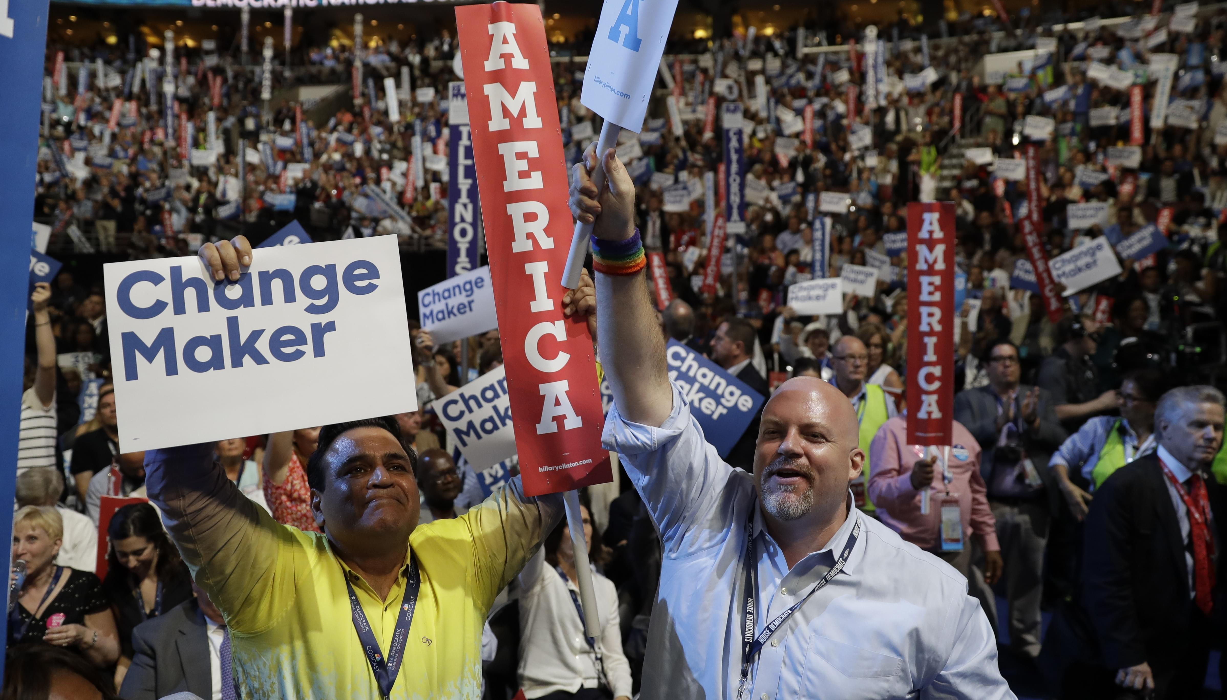 Illinois delegate Sunil Puri and supporter Jon Pyatt cheer during the second day session of the Democratic National Convention in Philadelphia.