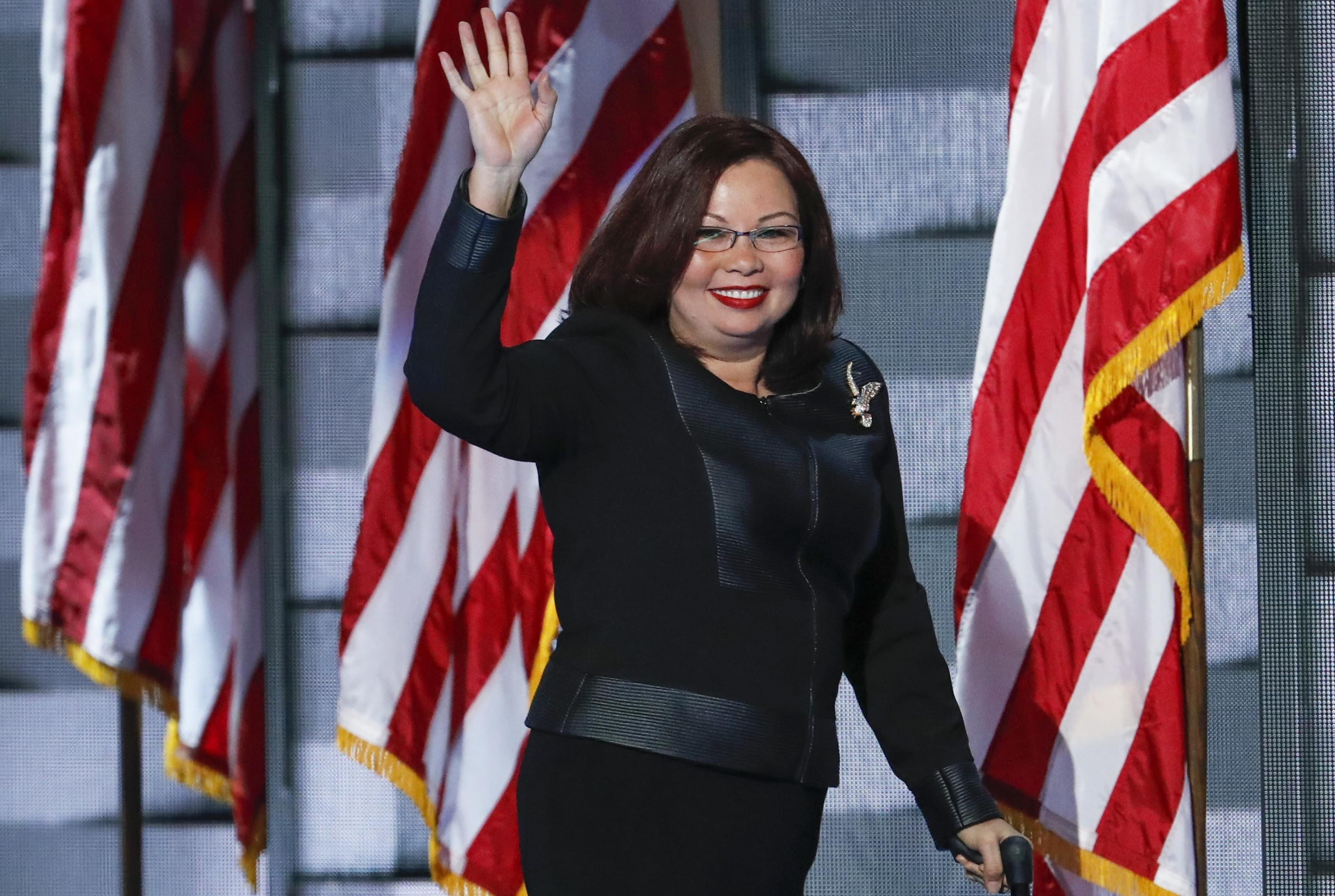 Rep. Tammy Duckworth, D-Ill., waves to delegates during the final day of the Democratic National Convention in Philadelphia, Thursday, July 28, 2016.