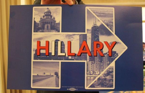A Hillary Clinton campaign sign featuring scenes from Illinois.