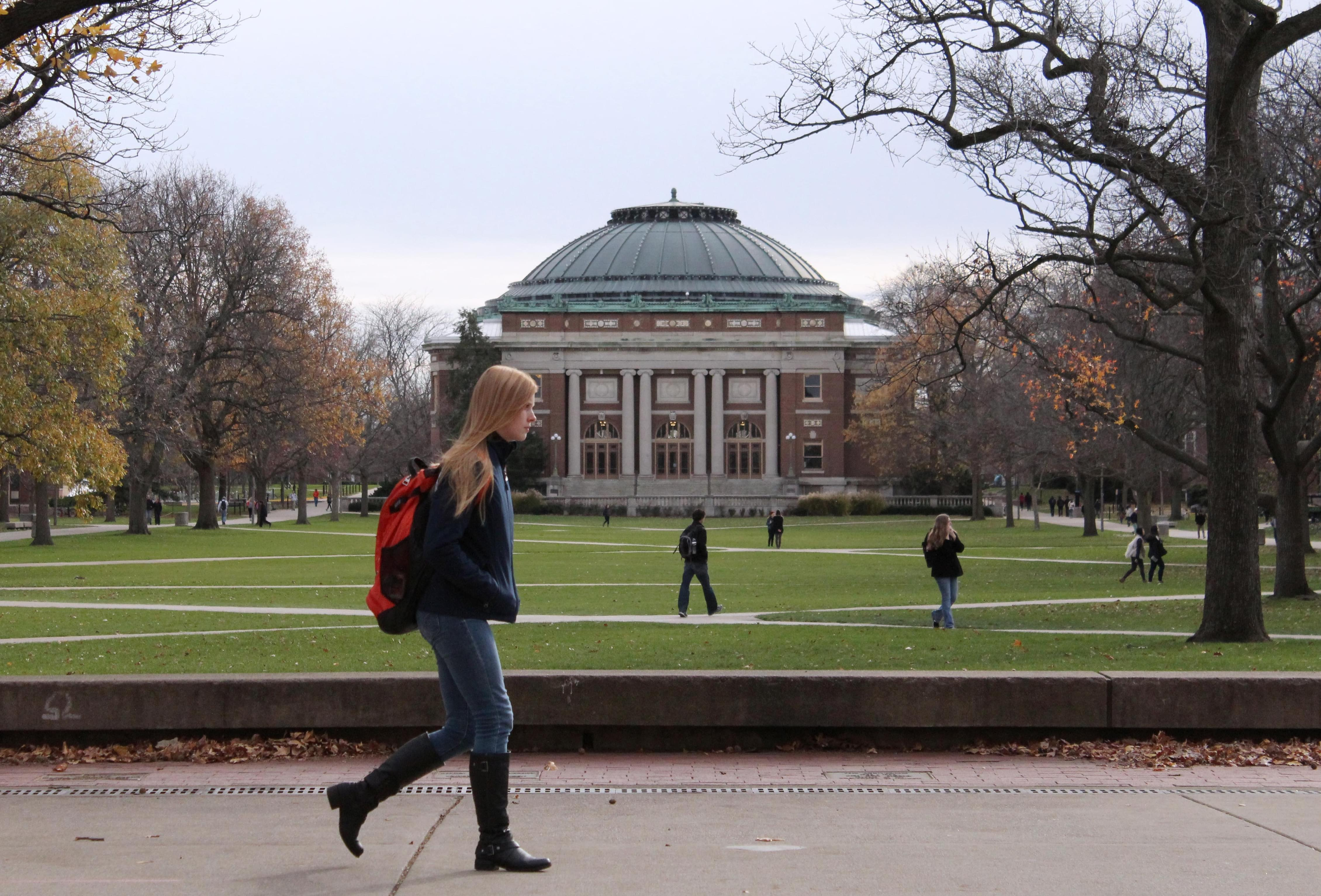 In this Nov. 20, 2015 file photo, University of Illinois students walk across the Main Quad on campus in Urbana, Ill. On Thursday, Jan. 21, 2016, university trustees approved a tuition freeze for instate freshmen.
