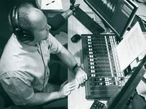 Brian Moline in broadcast booth using the new digital mixer