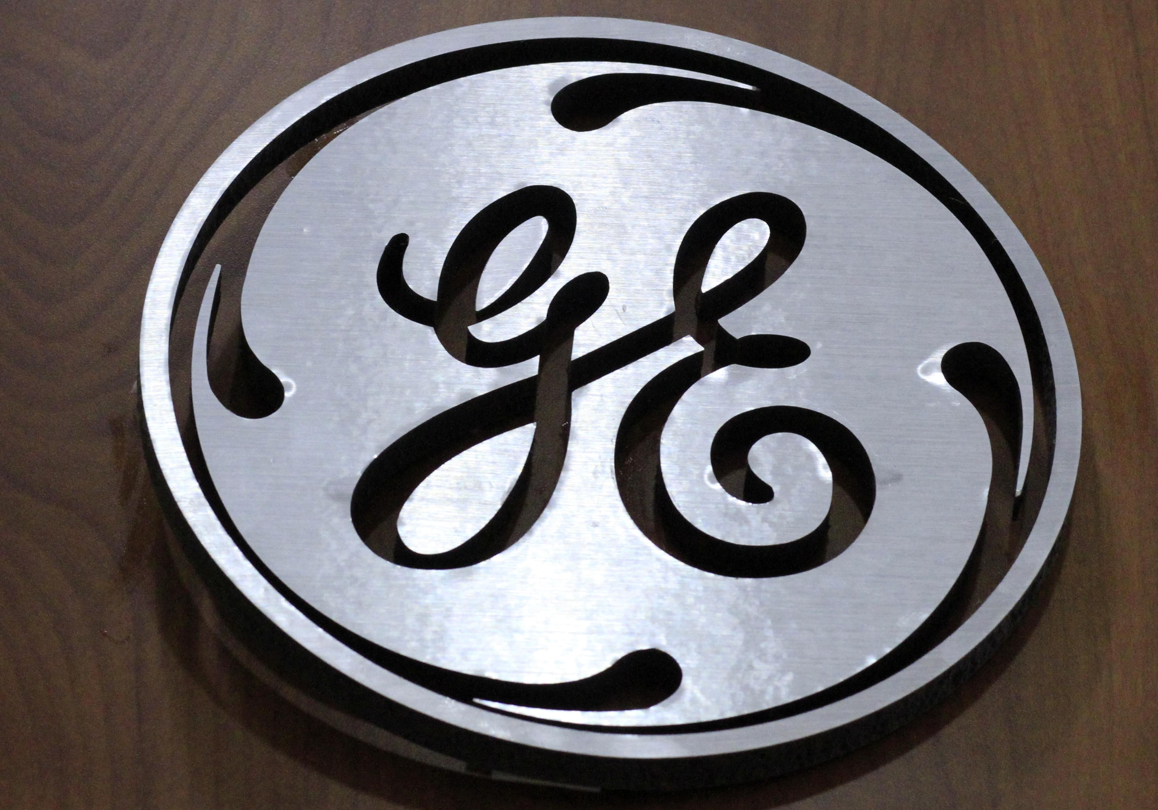 In this Thursday, Jan. 16, 2014, file photo, a General Electric logo is displayed at a store in Cranberry Township, Pa.