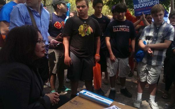 Tammy Duckworth addresses students at the the Democrats booth at University of Illinois Quad Day Sunday