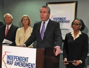 In this April 28, 2015 file photo, former Tribune Company CEO Dennis FitzSimons who is part of the group, Independent Map Amendment speaks at a news conference in Chicago.