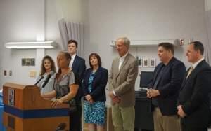 Lisa Creason, members of the Richland Community College staff, Gov. Bruce Rauner, and Senator Chapin Rose of Mahomet.