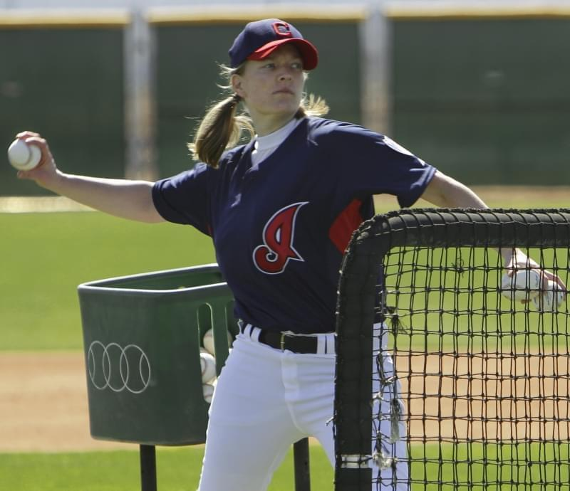 Justine Siegal throws batting practice to Cleveland Indians catchers during baseball spring training Monday, Feb. 21, 2011, in Goodyear, Ariz.