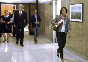 Illinois Gov. Bruce Rauner, left, and his wife Diana Rauner, right, walk down a hallway leading to a meeting of the governor's Cabinet on Children and Youth Thursday, June 9, 2016, in Springfield.