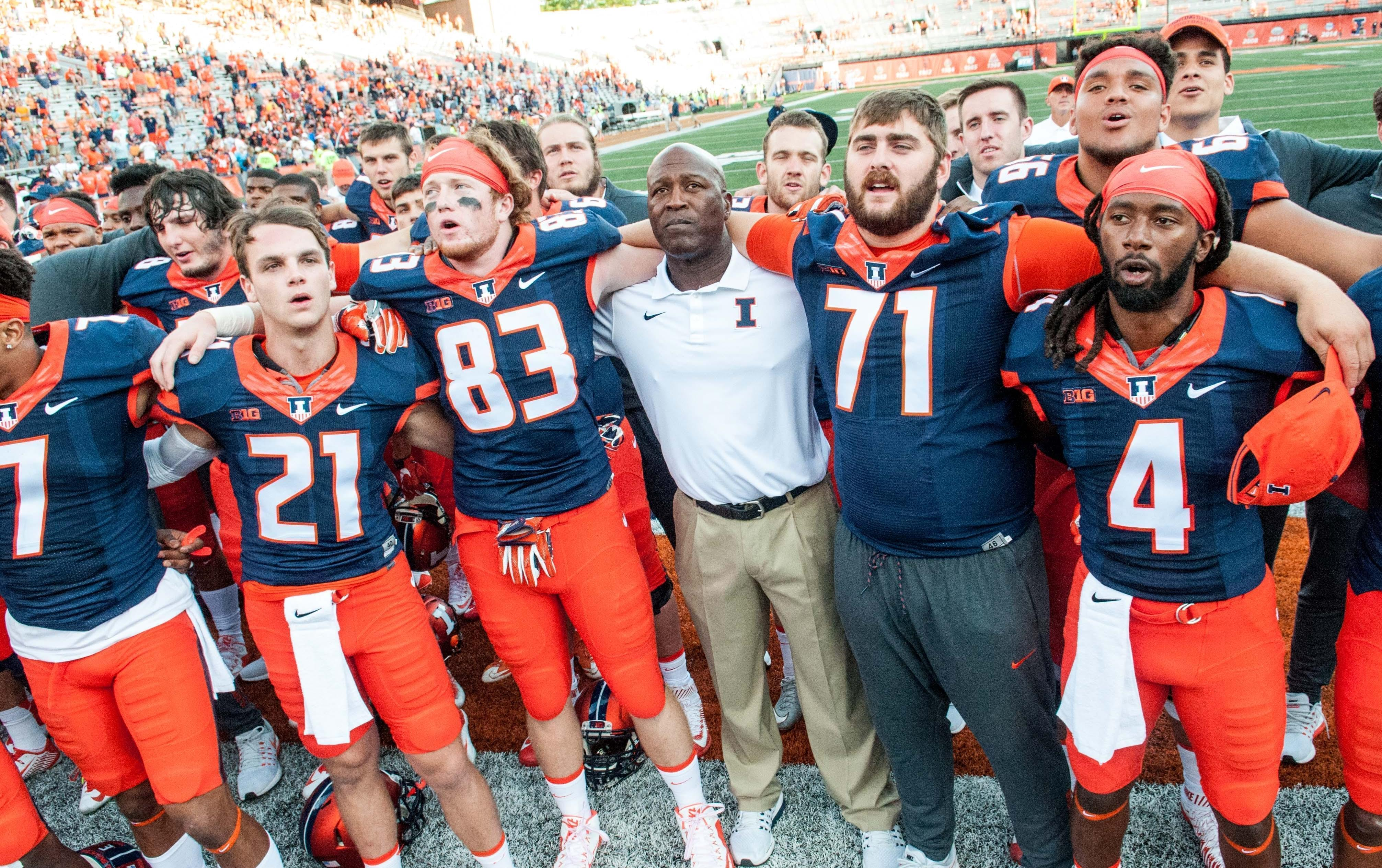 Illinois head coach Lovie Smith, center, sings the alma mater with the team after Illinois defeated Murray State 52-3 in an NCAA college football game Saturday, Sept. 3, 2016 at Memorial Stadium in Champaign.