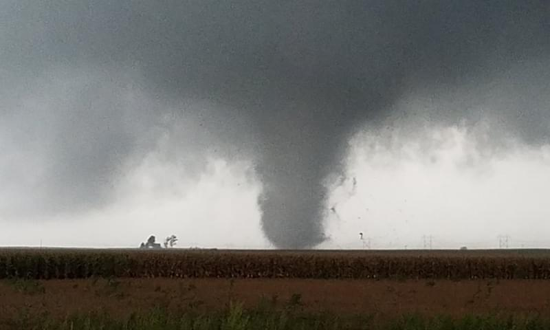 Image of tornado hitting a structure Southwest of Homer.