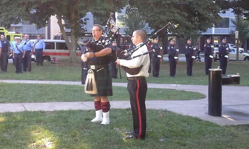 Two bagpipers at the 9-11 memorial ceremony at West Side Park in Champaign.