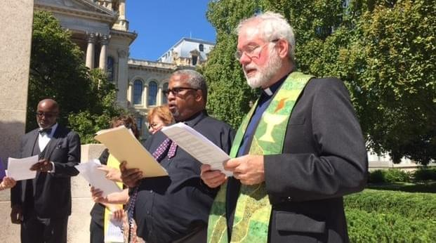 Rev. Booker Vance of Faith in Place and Rev. Martin Woulfe of the Abraham Lincoln Unitarian Universalist Congregation in Springfield, sing at the end of the Moral Monday rally.