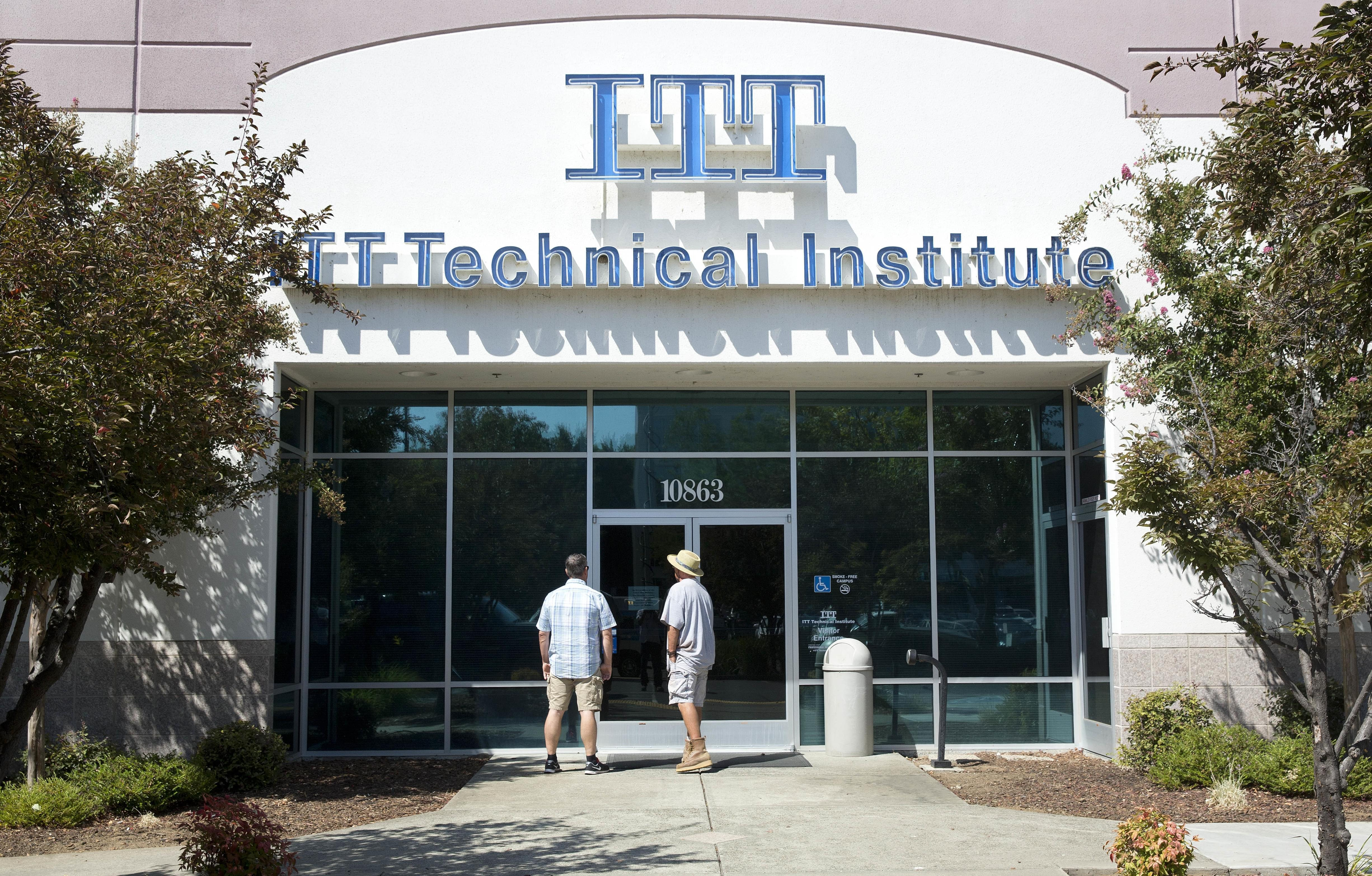 Harold Poling, left, and Ted Weisenberger found the doors to the ITT Technical Institute campus closed after ITT Educational Services announced that the school had ceased operating, Tuesday, Sept. 6.