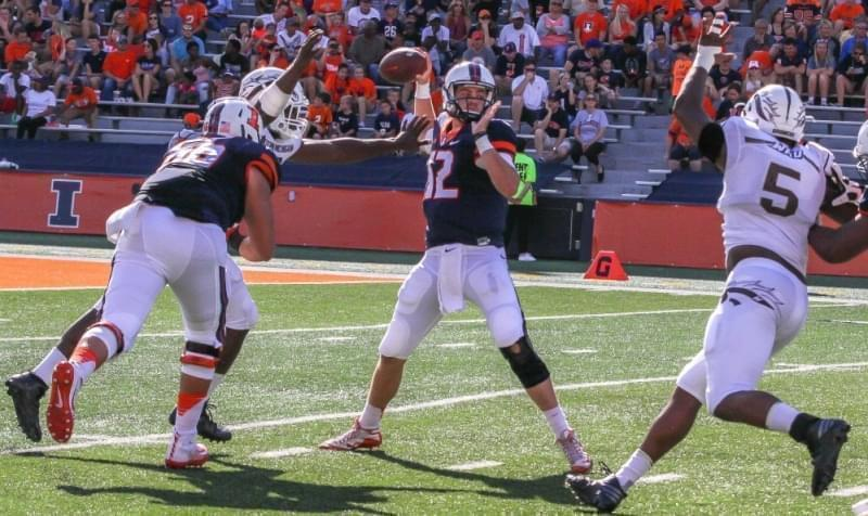 Western Michigan defenders close in on Illini quarterback Wes Lunt.