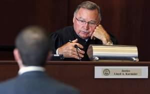 Illinois Supreme Court justice Lloyd A. Karmeier questions an attorney during oral arguments in Chicago.