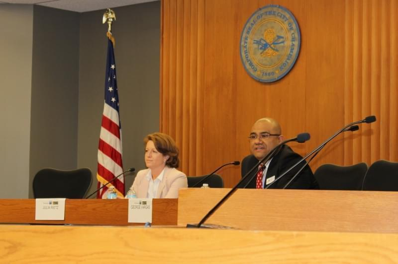 Champaign County State's Attorney Julia Rietz and Public Defender George Vargas debate during Tuesday's forum in the Champaign City Council chambers.