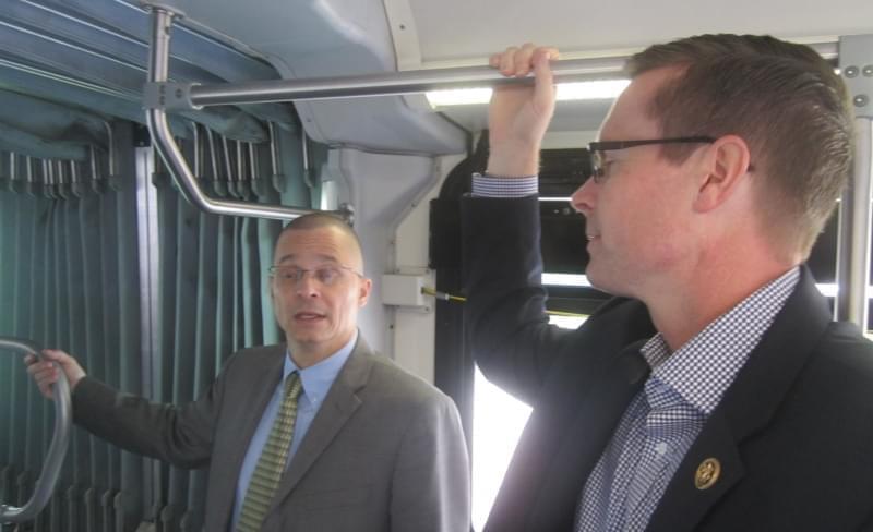 U.S. Rep. Rodney Davis rides a C-U Mass Transit bus with CUMTD managing director Karl Gnadt.