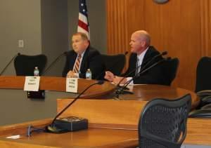 Senator Scott Bennett (D) and Republican Urbana Alderman Mike Madigan debate during Wednesday's forum at the Champaign City Building.