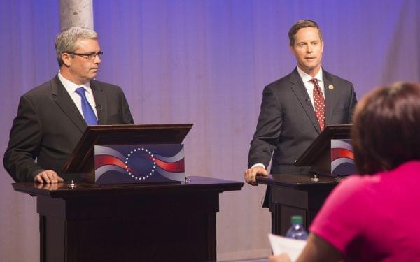 Democrat Mark Wicklund and incumbent Republican Congressman Rodney Davis debate one another Thursday at the WILL-TV studios.