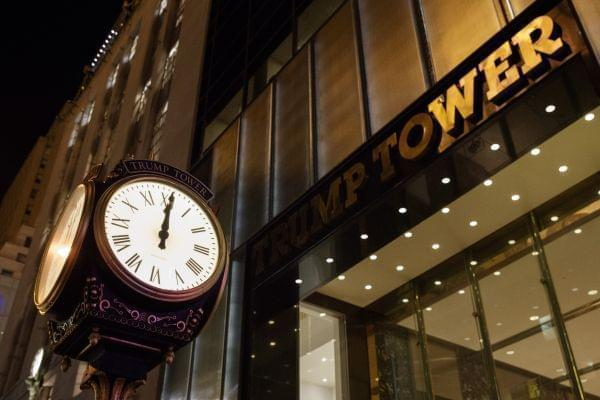A clock sits outside of Trump Tower at midnight on, Saturday, Oct. 8, 2016, in New York.