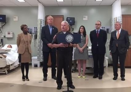 Sangamon County Sheriff Wes Barr joins Gov. Bruce Rauner, and other officials in promoting Illinois' attempt to expand services available to Medicaid recipients.