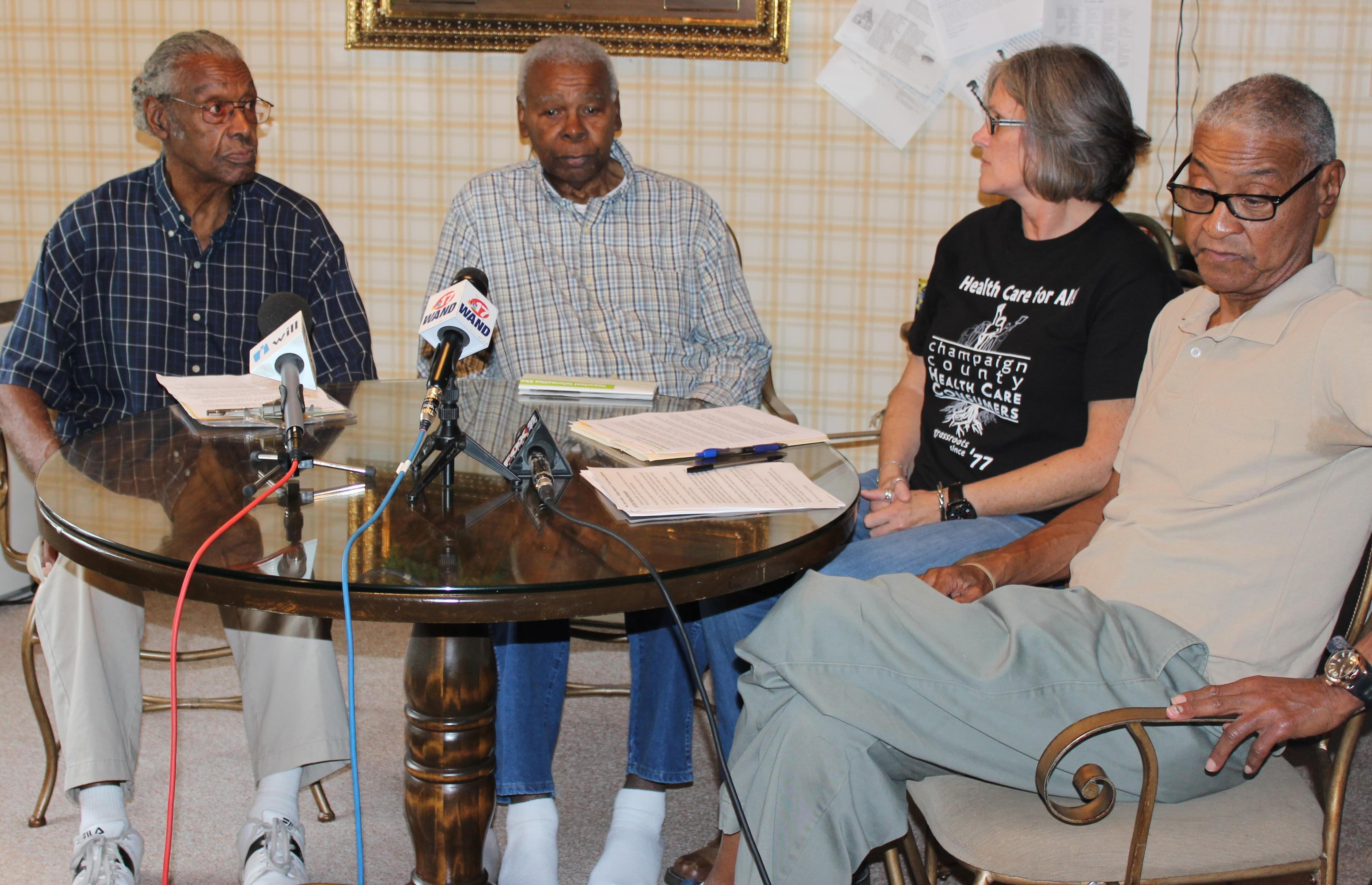 5th and Hill neighborhood residents M.D. Pelmore, Ebbie Cook, and Jerry Lewis meet with Claudia Lennhoff of Champaign County Health Care Consumers Tuesday at Pelmore's home in Champaign