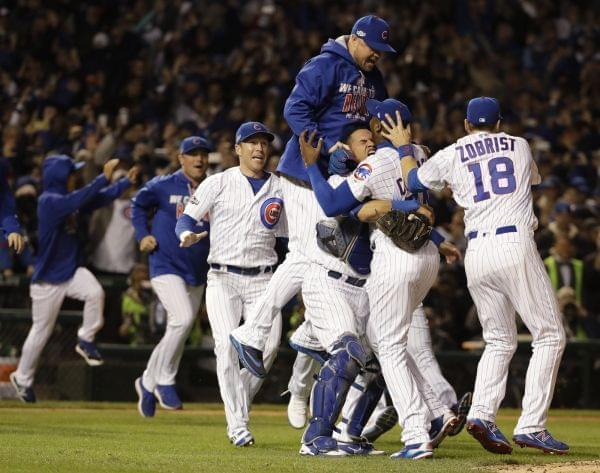 Cubs players celebrating after winning the 2016 National League pennant.
