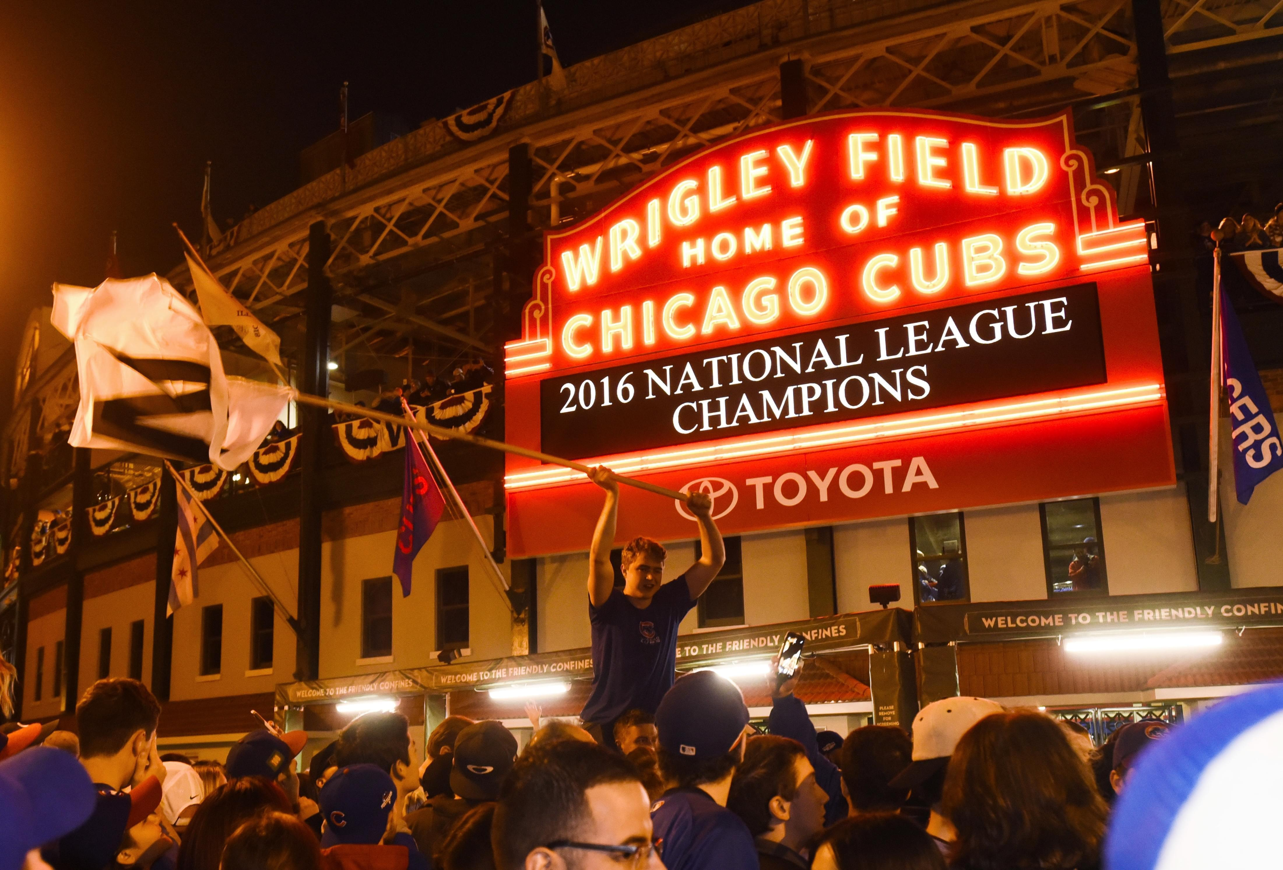 Chicago Cubs fans celebrate outside Wrigley Field after the Cubs defeated the Los Angeles Dodgers 5-0 in Game 6 of baseball's National League Championship Series, Saturday, Oct. 22, 2016, in Chicago. The Cubs advanced to the World Series.